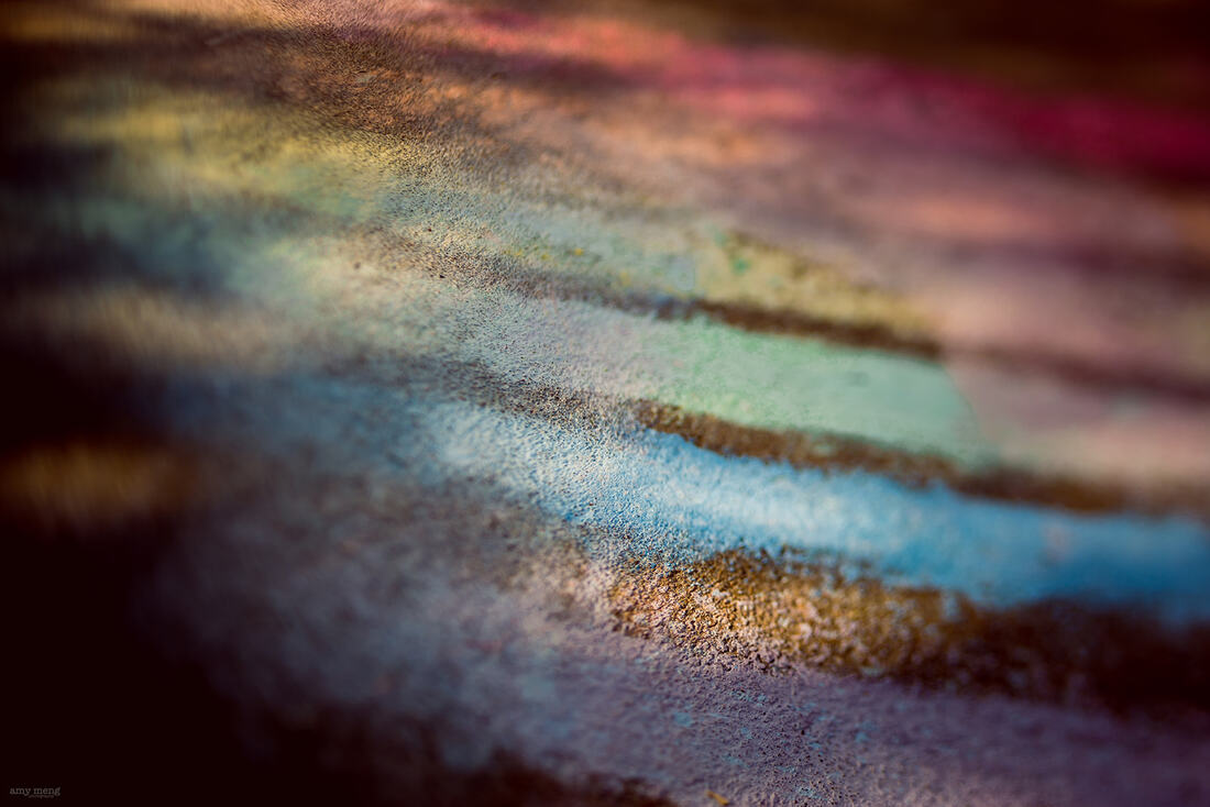 Rainbow chalk drawing by my youngest son photographed with my Lensbaby 35 lens in Manhattan, Kansas